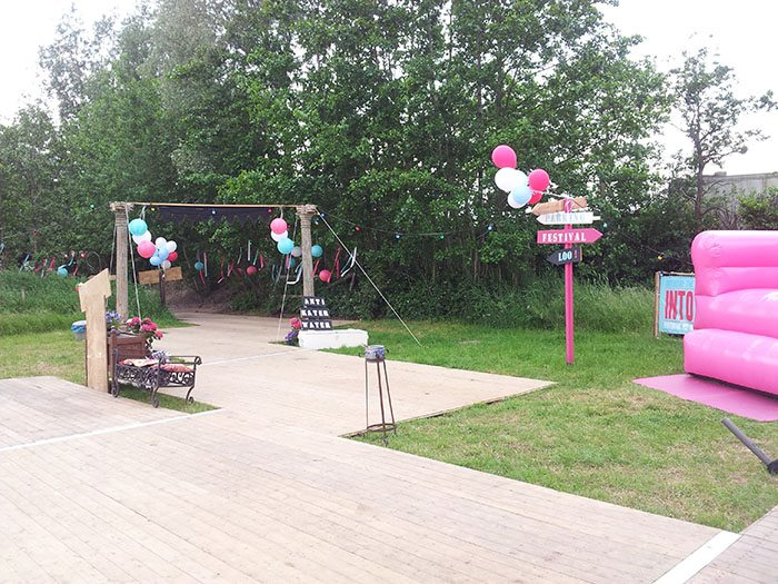 outdoor festival wedding venue with signage and camping facilities
