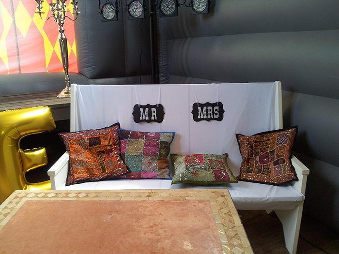 wedding chair with colourful cushions for the bride and groom