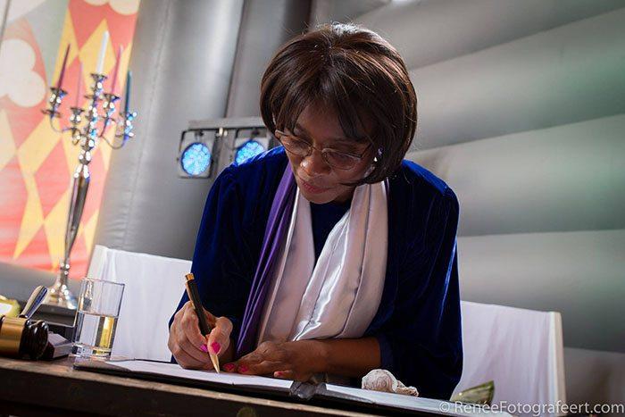 English Celebrant signing symbolic marriage certificate
