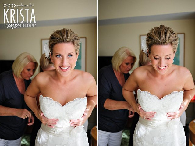 chief bridesmaid helping bride with her dress