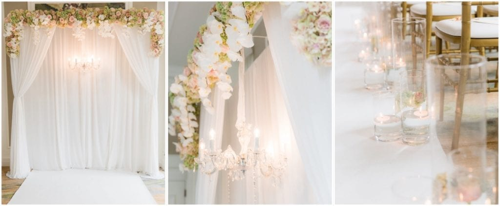 creme coloured wedding aisle, with white linen drapes over the archway, chandelier and colourful flowers