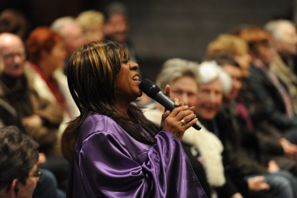 gospel zangeres dressed in a purple gown singing at maastricht gospelfestival in Holland
