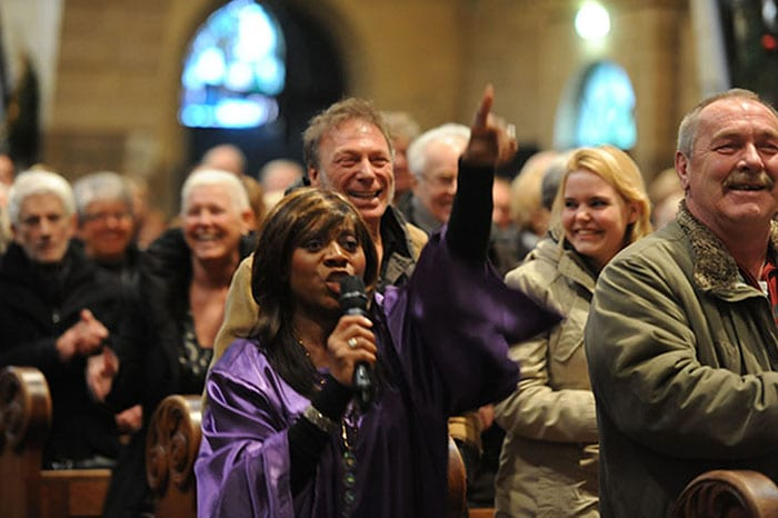 church wedding songs gospel zangeres dressed in a purple gown singing at maastricht gospelfestival in Holland