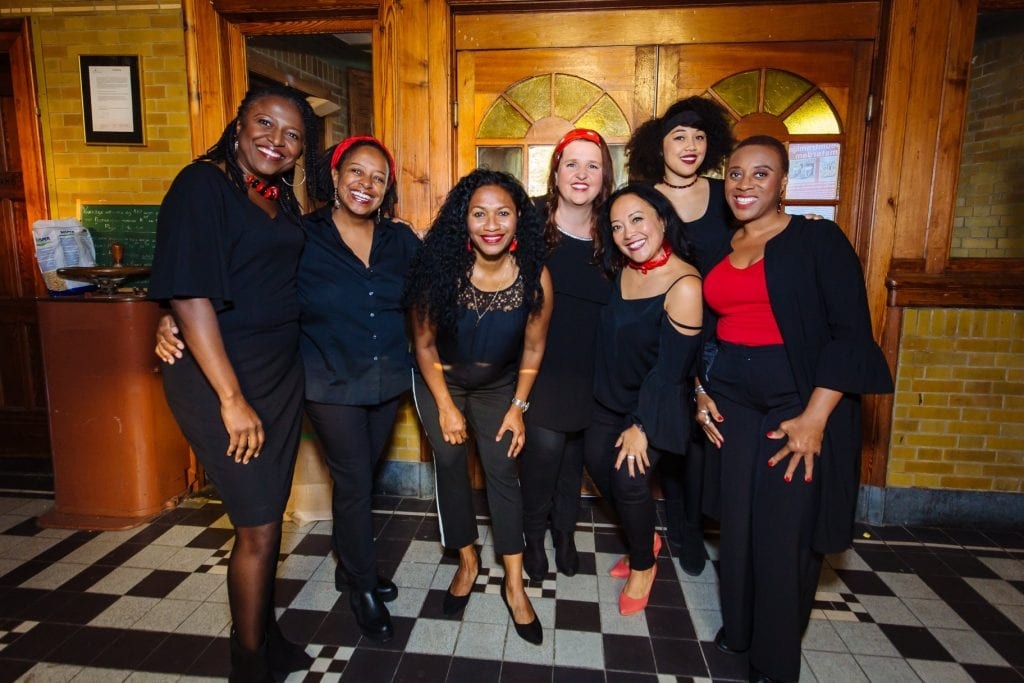 ABC Gospel Choir dressed in red and black outfits at Spacesworks Amsterdam