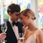 midweek weddings Amsterdam bride and groom drinking champagne