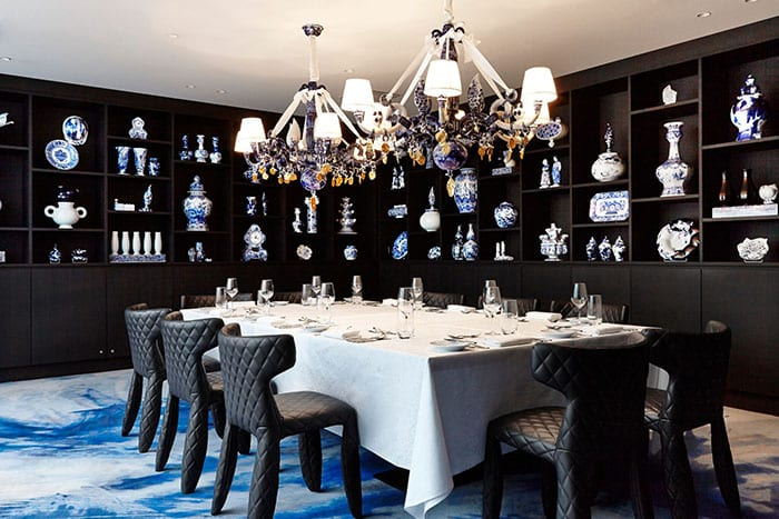 Midweek weddings private dinner party dining room with white table black seating and blue carpet at Andaz Hotel Amsterdam