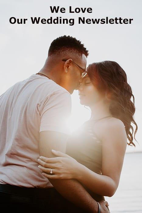 man wearing white shirt kissing woman on her nose