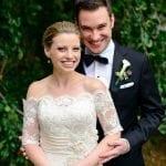 wedding budget groom in tuxedo huggingbride in white dress