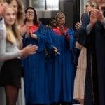 Amsterdam Choir grachtengordel gospelkoor two singers clapping, standing infront of wedding location