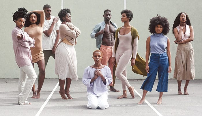 group of barefoot afro americans with different hairstyles