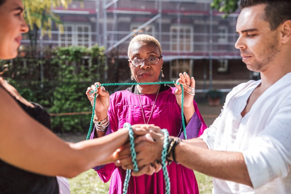 Memorable unity ceremony rituals celebrant binding couples hands with handfasting cord