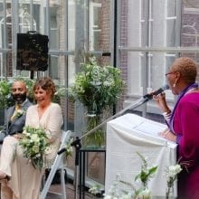 clover jean entertainment interracial weddings bride and groom laughing with the celebrant
