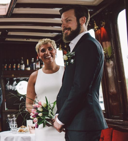 canal boat wedding real weddings bride holding bouquet and groom smiling