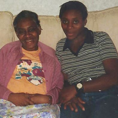 Funeral music and songs daughter sitting with mother on a cream coloured sofa chair