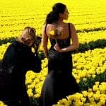 Dutch tulips photographer and bride holding tulip in a field
