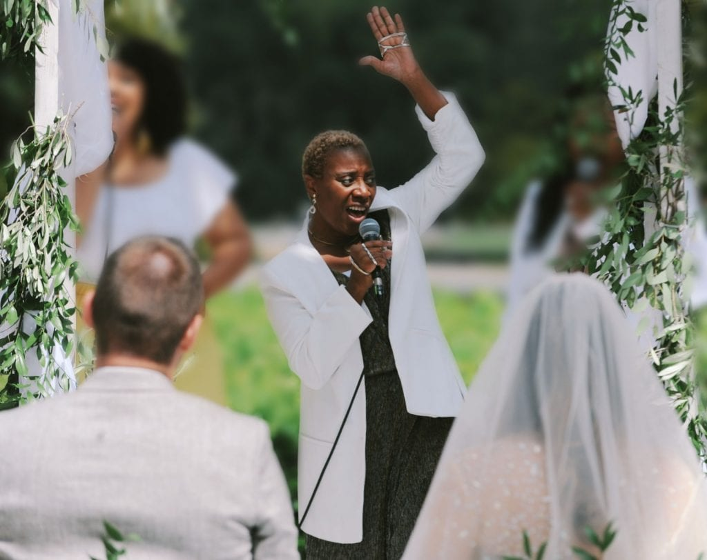 singer singing black gospel, soul and motown dressed in white and gold