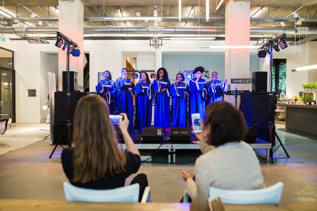 Funeral music and songs gospel choir dressed in purple gowns singing