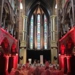 Dutch church wedding venues reception venue with tables and stain glass windows