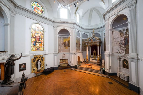 Dutch church weddings godly statues, wooden floor white walls and stained glass windows