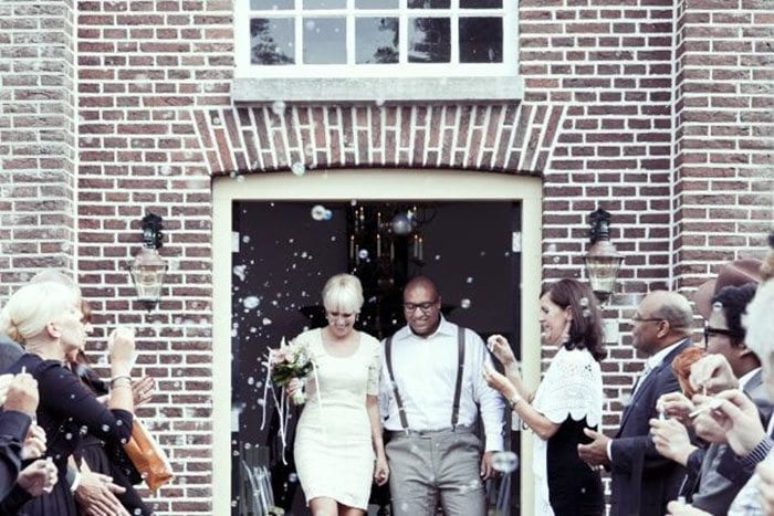 Dutch church weddings Happy couple leaving the church and guests congratulating them in an array of bubbles.