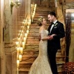 micro wedding celebration couple holding hands embraced standing at the bottom of stairs