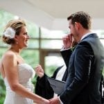 brides questions about marriage bride holding grooms hand, as he wipes a tear away from his cheek