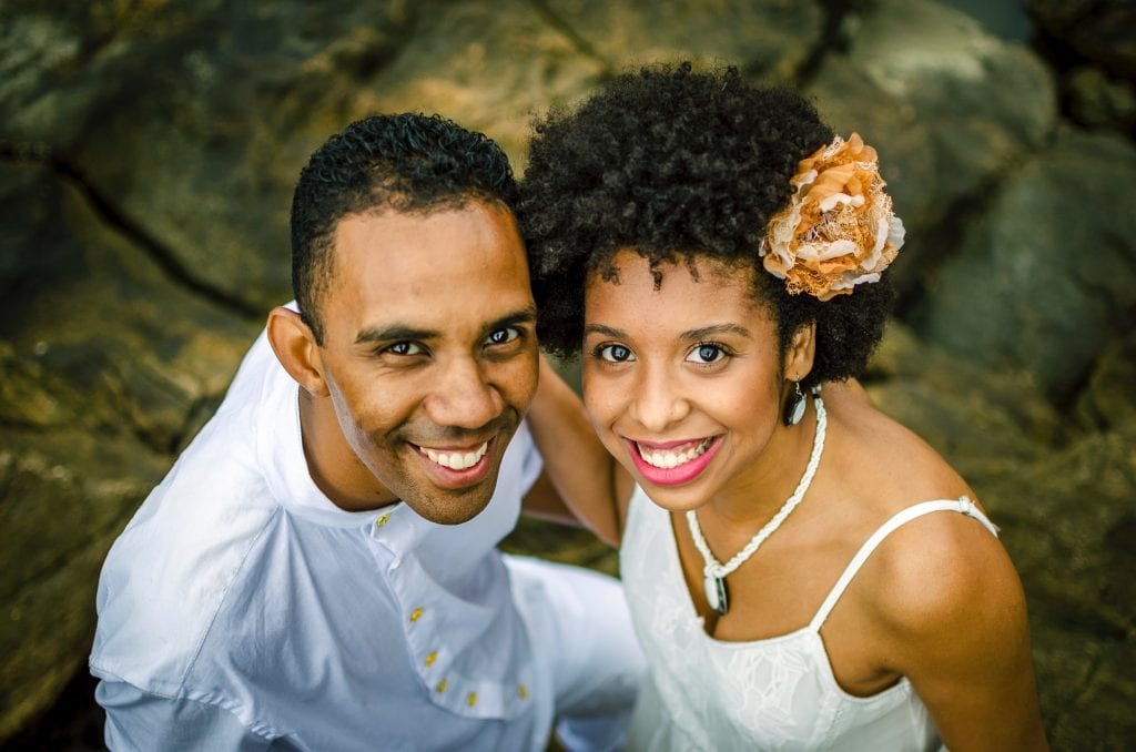 photo-of-a-man-and-woman-smiling-while-standing-on-rocks-