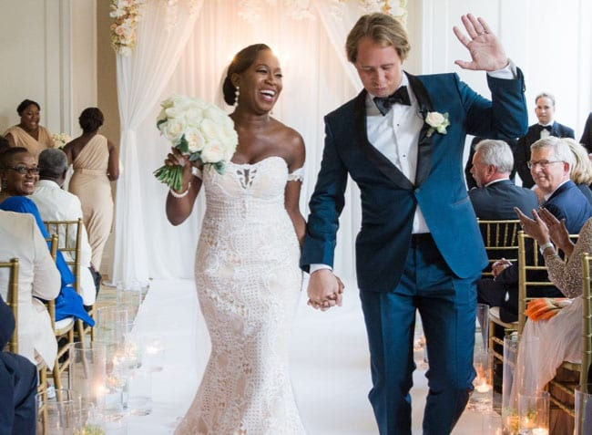 interracial weddings man and woman walking hand in hand down the aisle