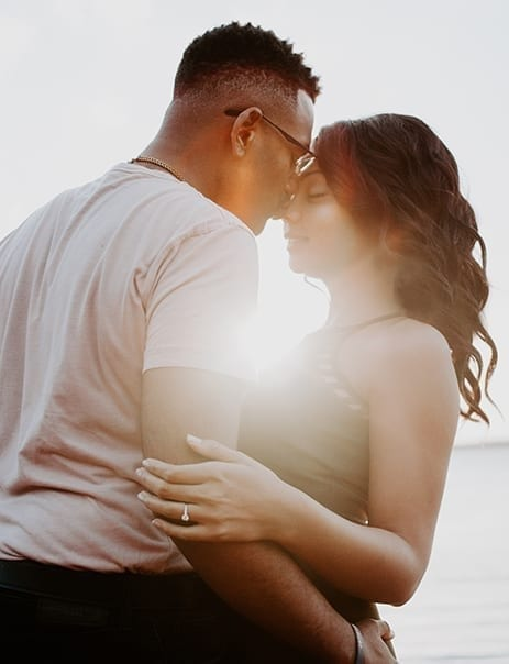 Wedding ceremony readings couple embracing and man kissing woman on the head