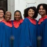 black gospel choirs 5 well-dressed singers performing at witte kerkje in Terheijden
