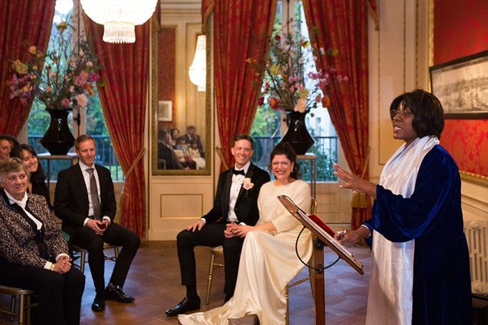 Het Grachtenhuis Herengracht Wedding Venue - Review couple smiling at the celebrant conducting the ceremony at Herengracht museum, Amsterdam