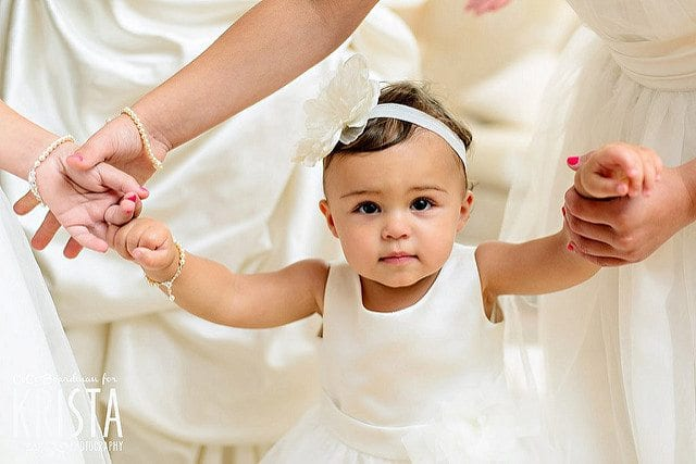 Non-Religious Christening Ceremonies little girl being held by mum's hand