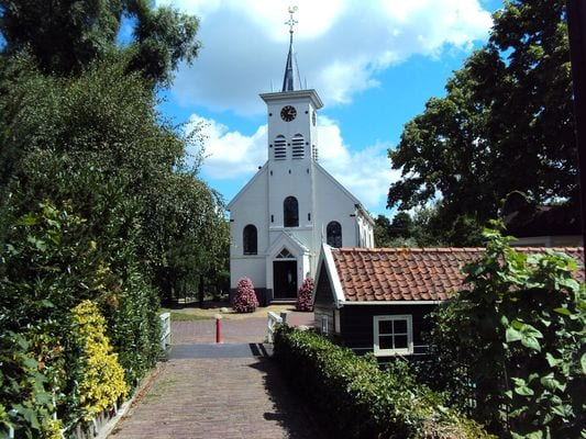 s white small church in the Dutch village of Schellingwoude