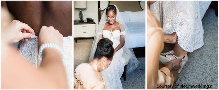tweetalige huwelijksceremonies bruid met bruidsmeisjes en gekleed in cremekleurige jurk en sluier