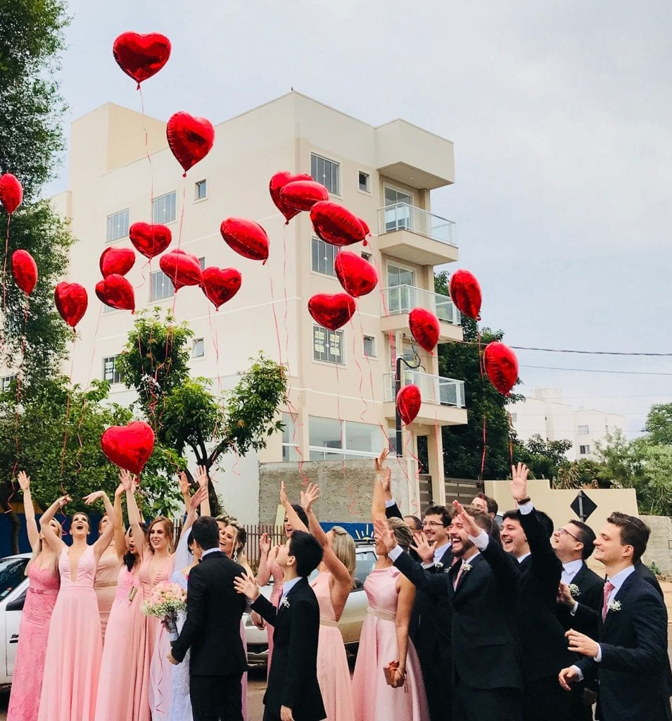 covid-19 wedding guest list people letting go of red ballons