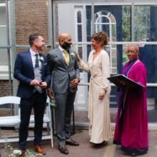beautiful pictures Dignita Hoftuin Weddings Amsterdamcelebration man holding rings standing with bridal couple