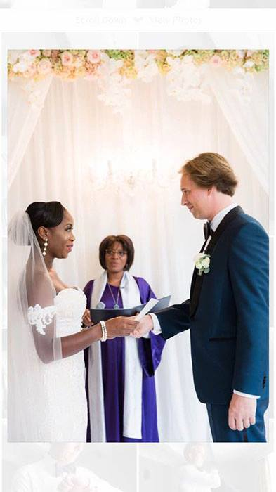 wedding reviews black bride in white laced dressed holding white grooms hand dressed in dark blue tuxedo