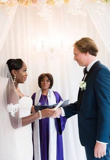 Wedding ceremony order of events couple holding hands and celebrant looking on