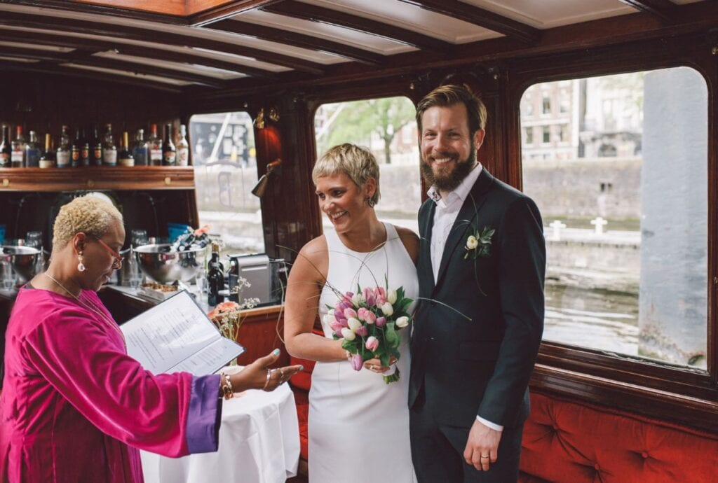 the sailing celebrant on a boat with happy wedding couple