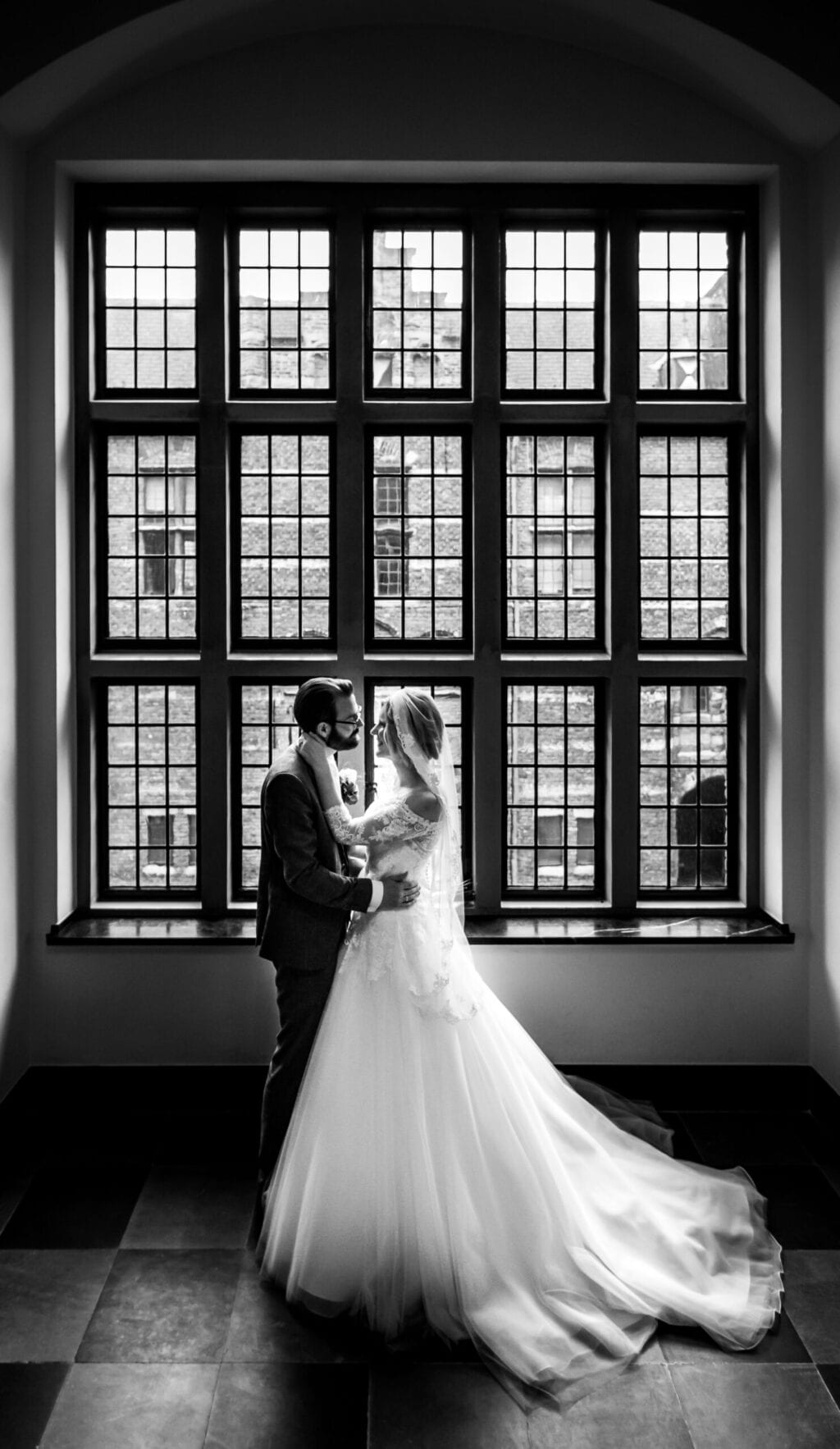 symbolic wedding ceremony planning couple posing in front of window