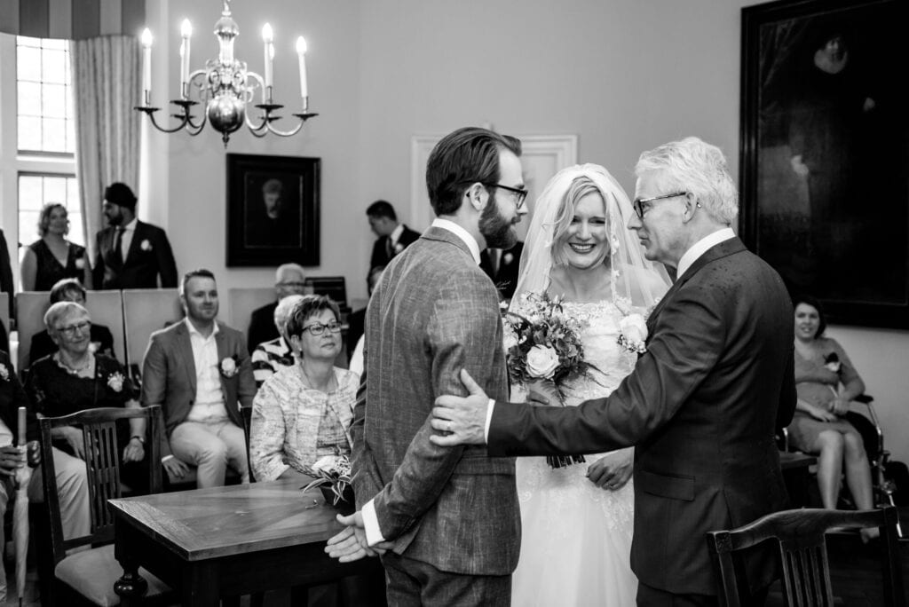 symbolic wedding ceremony father of the bride congratualing the happy couple