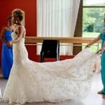 remote wedding planning styles bride with maid of honour tending to bridal dress
