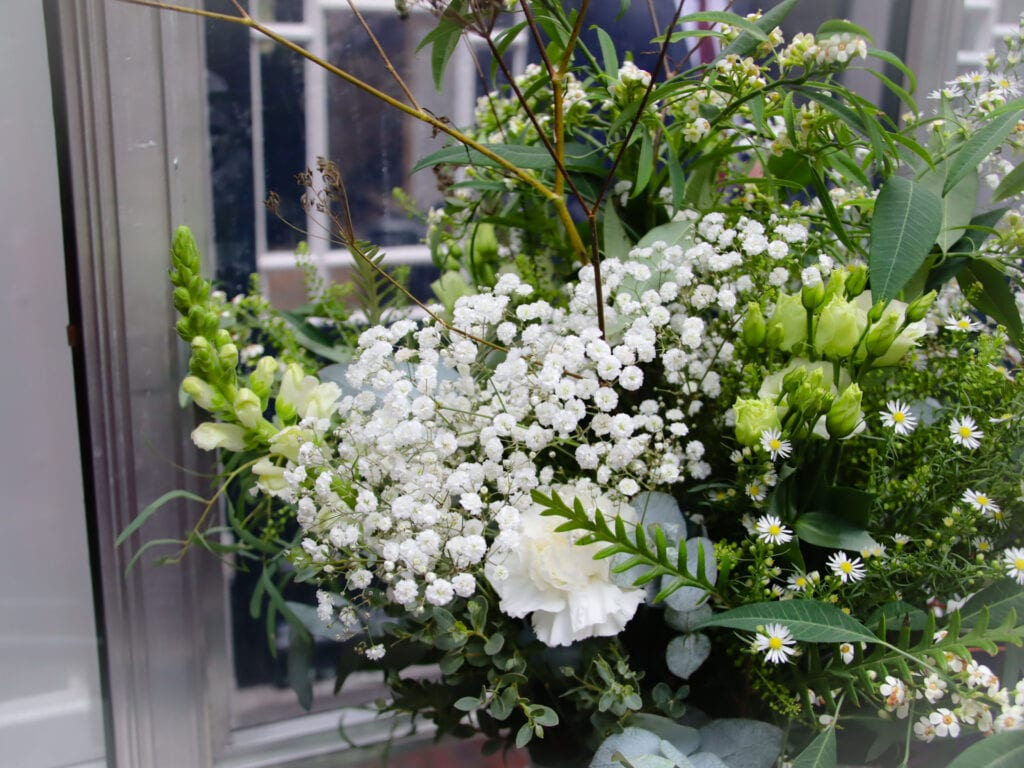 coronavirus weddings Beautiful bridal bouquet of white wildflowers and green foliage