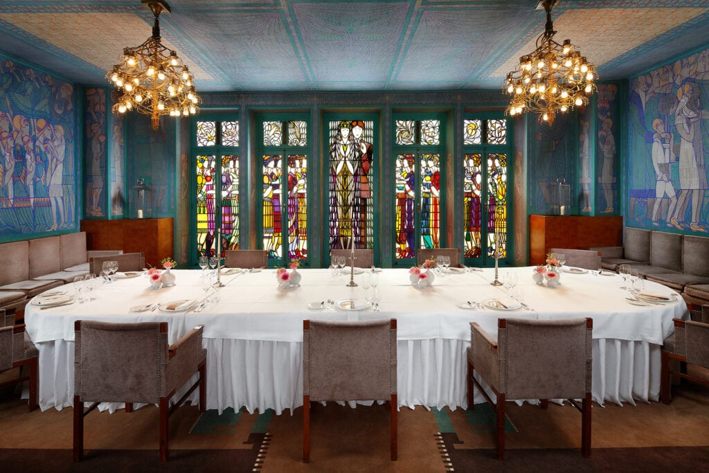 Dutch wedding planners grand marriage chamber with stained glass windows transformed into dining room