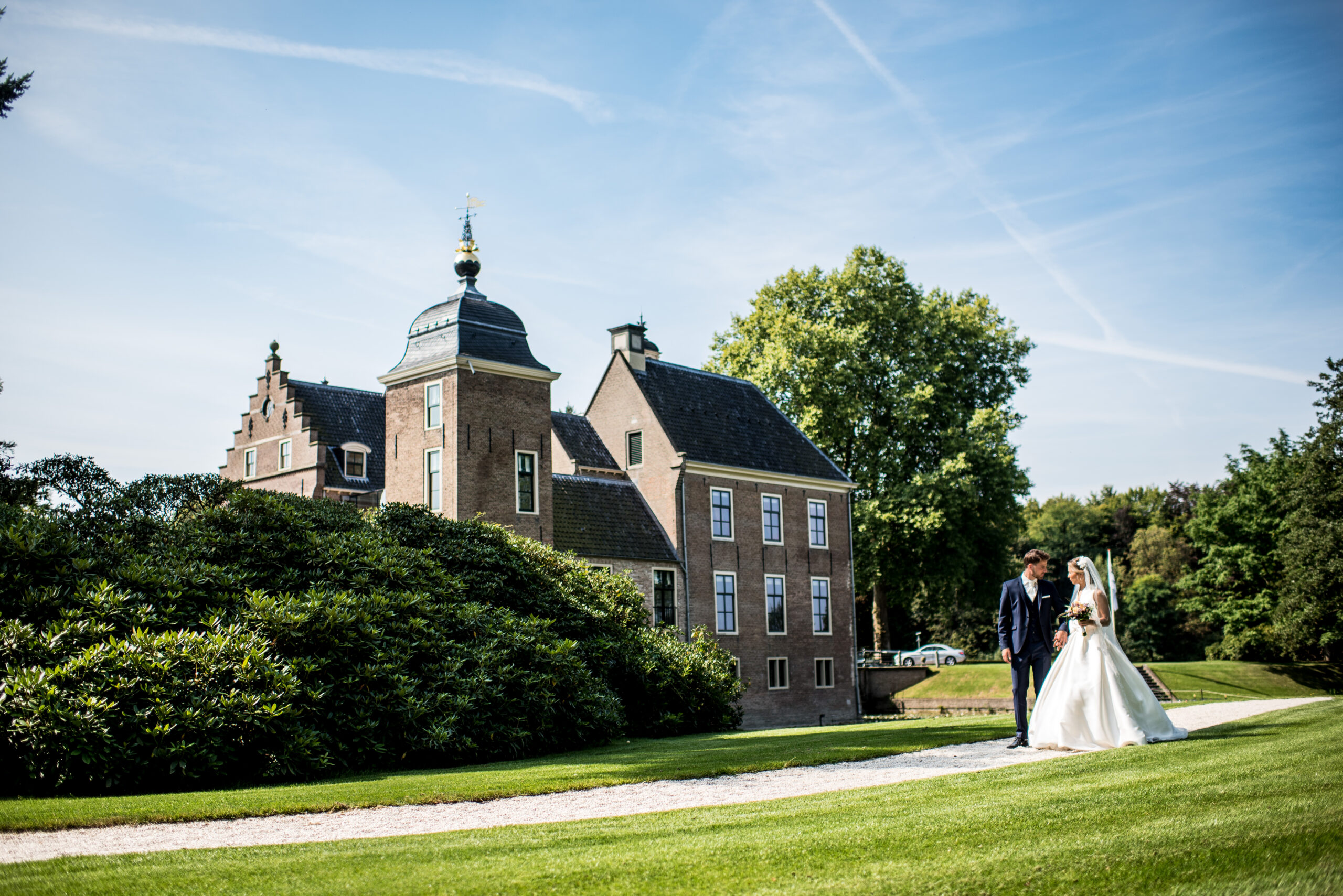 couple walking in castle grounds