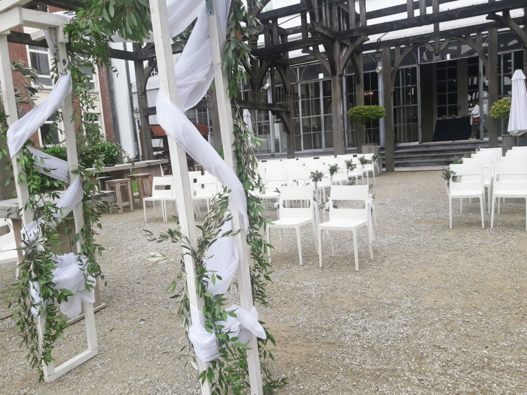 Beautiful orangery wedding venues tervuren belgium outdoor ceremony reception with white arch and chairs