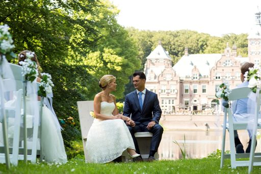 Dutch castle wedding venues happy couple at fairy-tale spot with incredible water views